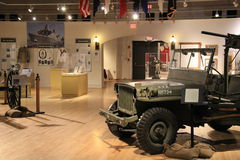 Wide-open room with display of historic war paraphernalia,New York State Military Museum and Veterans Research Center,2014 Royalty Free Stock Image