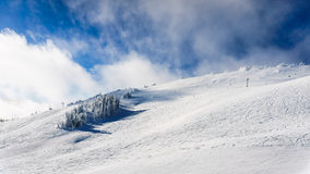 Wide open ski-able snowfields in the high alpine. Ski area at the village of Sun Peaks in the Shswap Highlands of central British Columbia, Canada Stock Photography