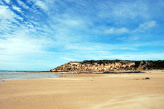 Wide open spaces at the beach. Coastal beach scene with biue sky and fluffy clouds Stock Photo