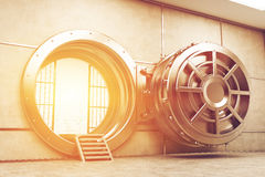 Wide open sunlit vault door Royalty Free Stock Photo