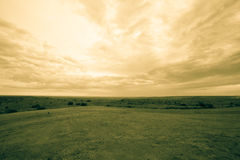 Wide open Texas landscape. Wide open Texas landscape under cloudy sky old-fashioned effect split toned photographic image Royalty Free Stock Photos