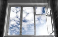 Wide open window. B/w frame, blue sky and bright sunlight. Concept image Royalty Free Stock Photos