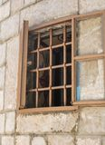 Wide open window with bars royalty free stock photography