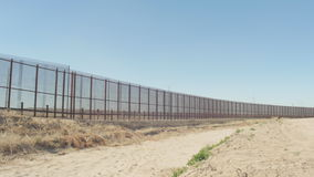 Wide Pan of Border Fence stock video