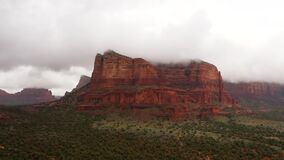 Wide panning drone shot of red rocks and canyons in Sedona, Arizona