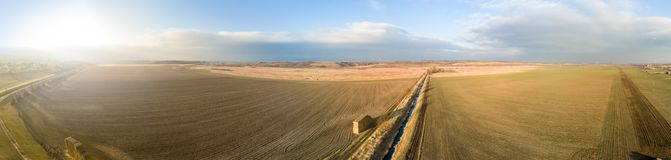 Wide panorama of an agricultural area stock images