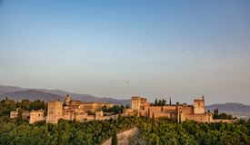 Arabic fortress of Alhambra at sunset in Spain. Wide panorama of the ancient arabic fortress of Alhambra at dusk Royalty Free Stock Photo