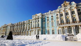Wide Panorama of Catherine Palace in Pushkin city. Wide Panorama of Catherine Palace and French Garden , walking people, on a sunny day in winter in Pushkin ( stock video footage