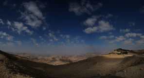 Wide  panorama on  desert with cloudscape. Wide panorama on the mountain top view of the desert and the sky with clouds, Jordan, Petra Stock Photos