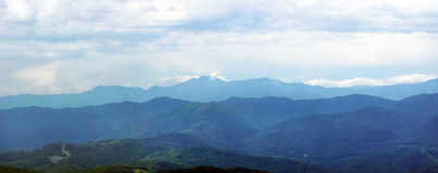 Wide panorama of forested mountains Royalty Free Stock Photography