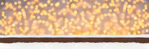 Wide panorama illuminated lights wooden christmas bokeh backgrou Stock Photos