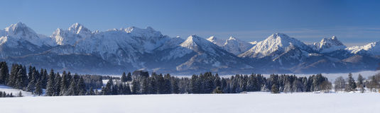 Wide panorama landscape in Bavaria with alps mountains and lake in winter Stock Image