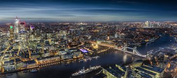 Wide panorama of London, United Kingdom, by night royalty free stock photos
