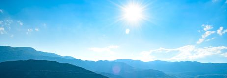 Wide Panorama of Mountains under Bright Sun in the Morning Time royalty free stock images