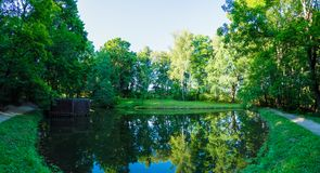 A wide panorama of the pond on the territory of the Yasnaya Poly
