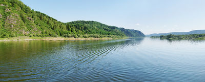 Wide panorama of a river and the forested mountain Stock Photography