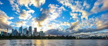 Wide panorama of Sydney, Australia with amazing sunset and clouds over the city skyline and Botanic Gardens stock images