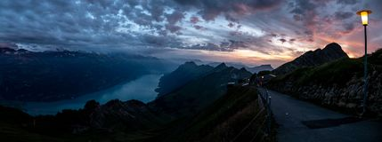 Wide panorama view of mountain range during dramatic snuset from the brienzer rothorn in the swiss alps. Cloudy royalty free stock photography