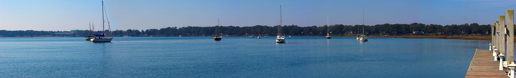 Wide panorama of water and sailboats Royalty Free Stock Photography