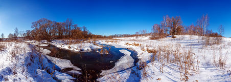 Wide Panorama Winter Landscape with Forest and River Royalty Free Stock Image