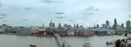Wide panoramic aerial view of the city of london with historic landmarks and building in the business district with bridge. Wide panoramic aerial view of the Stock Photos