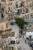 Wide panoramic cityscape view of Matera, Italy. MATERA, ITALY - AUGUST 27, 2018: Warm scenery summer day high angle close-up street view of amazing ancient town royalty free stock photo
