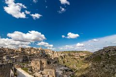 Wide panoramic cityscape view of Matera, Italy. MATERA, ITALY - AUGUST 27, 2018: Warm scenery summer day view of the amazing ancient town of the famous Sassi stock photography