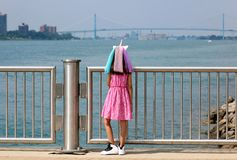 Beautiful little girl at Detroit Michigan, high definition picture of the Ambassador bridge between USA and Canada. Wide panoramic high definition picture of the royalty free stock photos