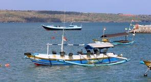 Beautiful picture of fishing boats at Jimbaran Bay at Bali Indonesia, beach, ocean, fishing boats and airport in photo. Wide panoramic picture of Jimbaran Bay royalty free stock photo