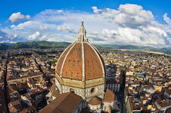 Wide panoramic view of Florence with a dome of Santa Maria del Fiore cathedral in front Royalty Free Stock Photo