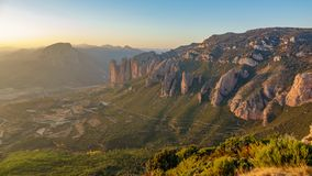 Mallos of Riglos at dusk from top of the mountain. Wide panoramic view of Mallos of Riglos at sunset from top of viewpoint Royalty Free Stock Photo