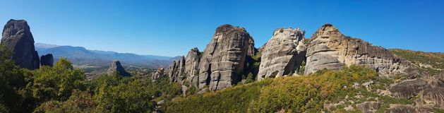 Wide panoramic view of the Meteora rock monasteries in Greece Royalty Free Stock Photos
