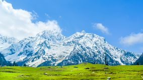 Wide panoramic view of snow covered mountain peak and blue sky with clouds in Baisaran Valley Mini Switzerland, Pahalgam, stock photos