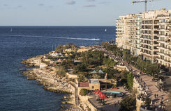Wide promenade and sea front at Sliema on Malta. Wide promenade, public park and sea front at Sliema on Malta Stock Photography
