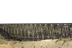 Wide railway bridge. Panoramic view of wide or long old railway bridge with wooden supports in countryside Royalty Free Stock Image