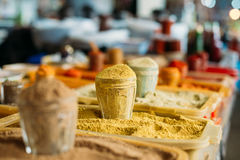 Wide Range Of Multicolored Powdered Fragrant Spices At Showcase Royalty Free Stock Photography