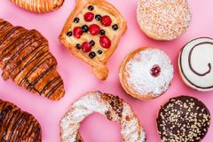 A wide range of pastry cakes, donuts, pretzels, pink, sweets stock photography
