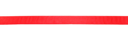 Wide red satin ribbon isolated on white Royalty Free Stock Images