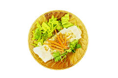 Wide rice noodle roll on dish isolated Stock Photo