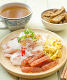 Wide Rice Noodle Rolls(Kuay Teow Lot). And hot tea Royalty Free Stock Image