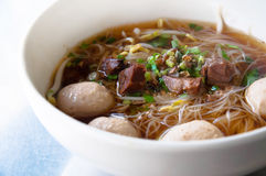 wide rice noodle soup with vegetables and beef Stock Images