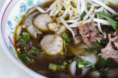 Wide rice noodle in thick soup with beef Stock Images