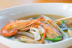 Wide rice noodles in gravy with seafood Royalty Free Stock Photos