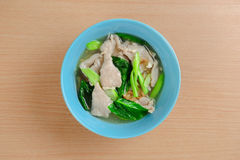 Wide rice noodles in gravy. Noodles in thick gravy with pork and flower on the table Royalty Free Stock Image