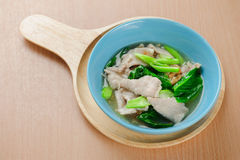 Wide rice noodles in gravy. Noodles in thick gravy with pork and flower on the table Stock Photo