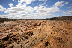 Wide river bed Betsiboka, flushes red soil after heavy rains in Madagascar Stock Photo