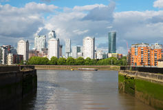 Wide river canal, city skyline, residential buildings on the oth Royalty Free Stock Photo
