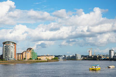 Wide river canal, city skyline, residential buildings on the oth Stock Image