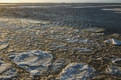Wide river freezing in sunny winter day. Ice formation. Sugar.  stock photography