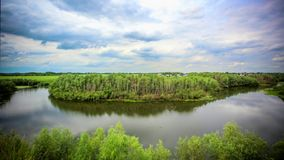 Wide river with green coasts and sky with clouds stock footage